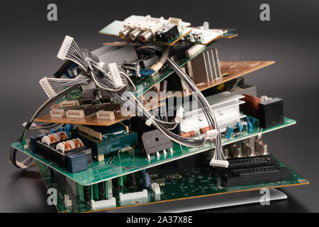 electronic PCB garbage as background from recycle industry and old consumer devices - Stock Photo