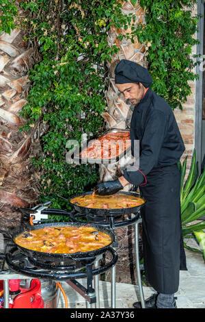 Traditional preparation of seafood paella rice, Barcelona, Catalonia, Spain Stock Photo