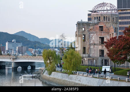HIROSHIMA, JAPAN – NOVEMBER 23, 2007: The view of the Atomic Bomb Dome - skeletal ruins of the former Hiroshima Prefectural Industrial Promotion Hall - Stock Photo