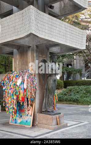 HIROSHIMA, JAPAN – NOVEMBER 23, 2007: Goddess of Peace and the garlands of  folded paper cranes at the base of Memorial Tower to the Mobilized Student - Stock Photo