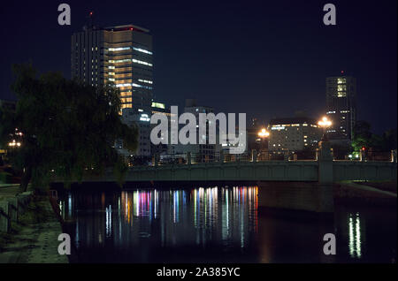 HIROSHIMA, JAPAN - NOVEMBER 23, 2007: The view of the Ota River with Aioi Bridge,  the aiming point for the Atomic bombing of Hiroshima, at the night - Stock Photo