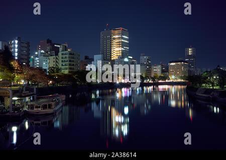 HIROSHIMA, JAPAN – NOVEMBER 23, 2007: The view of the Ota River at night lights. Hiroshima. Japan - Stock Photo