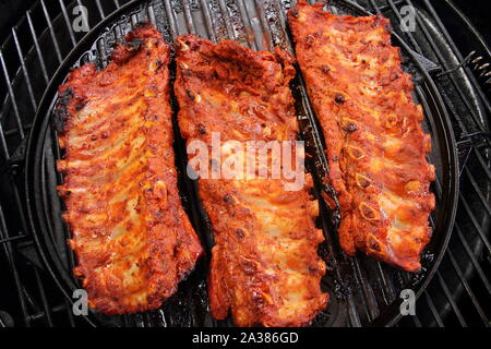 delicious spare ribs on the grill - Stock Photo
