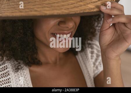 Portrait of pleased woman that wearing hat