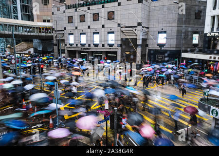 Hong Kong, China. 6th Oct, 2019. Protestors take part in the march in Central, Hong Kong. It was the second day after Hong Kong's government invoked emergency powers to enact a ban on wearing face masks in public on Friday October 4th. Violence continued throughout Hong Kong as protesters set fires and vandalized subway stations, restaurants, banks and many other public facilities. Credit: Keith Tsuji/ZUMA Wire/Alamy Live News - Stock Photo