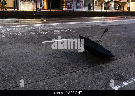 Hong Kong, China. 6th Oct, 2019. An umbrella is seen in Wan Chai district. It was the second day after Hong Kong's government invoked emergency powers to enact a ban on wearing face masks in public on Friday October 4th. Violence continued throughout Hong Kong as protesters set fires and vandalized subway stations, restaurants, banks and many other public facilities. Credit: Keith Tsuji/ZUMA Wire/Alamy Live News - Stock Photo