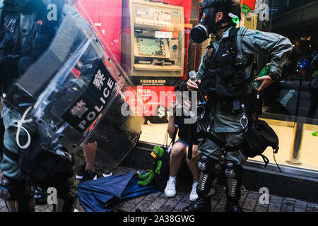 Hong Kong, China. 6th Oct, 2019. A protestor is arrested by the riot police in Wan Chai district. It was the second day after Hong Kong's government invoked emergency powers to enact a ban on wearing face masks in public on Friday October 4th. Violence continued throughout Hong Kong as protesters set fires and vandalized subway stations, restaurants, banks and many other public facilities. Credit: Keith Tsuji/ZUMA Wire/Alamy Live News - Stock Photo