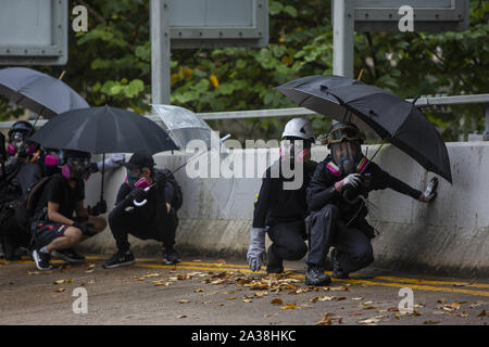 Hong Kong, China. 6th Oct, 2019. Thousands of pro democracy protesters gathered in Hong Kong's Causeway Bay area to take park in continued protests against the mask ban. The march passed through the Admirlaty and Central areas of Hong Kong Island and eventually led to confrontations with police in several parts of the city. Credit: Adryel Talamantes/ZUMA Wire/Alamy Live News - Stock Photo
