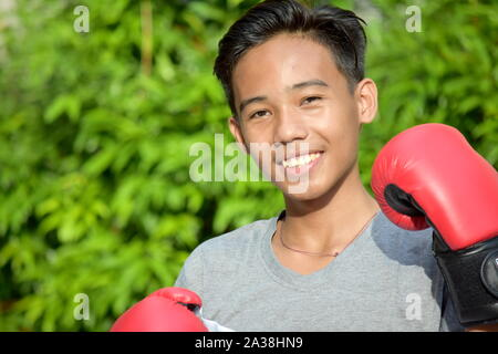 Happy Fitness Minority Person Wearing Boxing Gloves - Stock Photo
