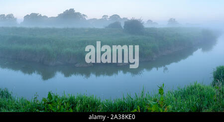 A misty morning on the banks of the River Adur near Partridge Green, West Sussex, England - Stock Photo