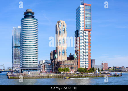 The old Holland Amerika Lijn (Holland America Line) building, now Hotel New York, surrounded by modern office blocks, Rijnhaven, Rotterdam, Netherland - Stock Photo