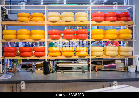 Large number of cheeses at a Dutch cheese shop, Rotterdam, Netherlands - Stock Photo