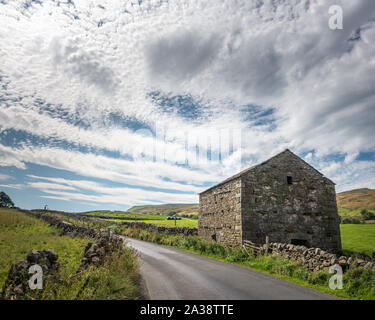 Old Yorkshire stone barn in Mallerstang Dale with Wild Boar Fell behind, Yorkshire Dales National Park, UK landscape - Stock Photo