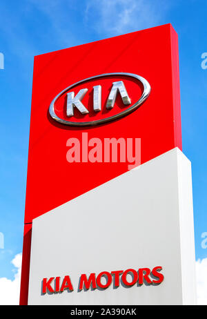 Veliky Novgorod, Russia - August 23, 2019: KIA Motors dealership logo. Kia Motors is South Korea's automobile manufacturer - Stock Photo