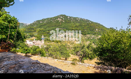 Beautiful landscape with church and mountain in background, Valldemossa, Mallorca, Spain - Stock Photo