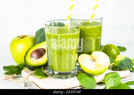 Green smoothie from fruit and vegetable on white. - Stock Photo