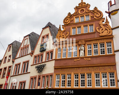TRIER, GERMANY - SEPTEMBER 25, 2012: Main Market Square buildings, partial exterior view with the Red House, Rote Haus from 1684 - Stock Photo
