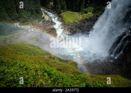 Rainbow over Krimml Waterfalls, High Tauern National Park, Salzburg, Austria - Stock Photo