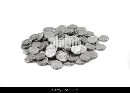 A close up image of a pile of Pakistani rupees isolated on a clean, white background - Stock Photo