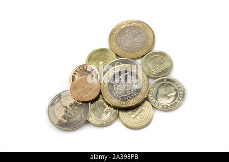 An assortment of coins from Turkey, shot close up in macro, on a clean, white background - Stock Photo