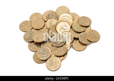A close up pile, shot in macro, of a pile of Russian ten kopeyka coins on a clean, white background - Stock Photo