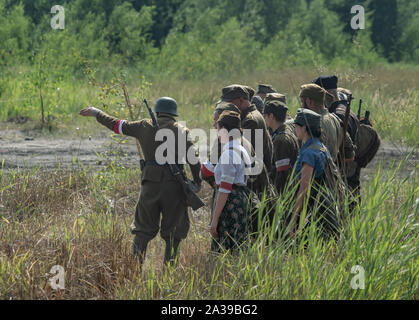 Polish partisans from the Home Army (AK) during Military Vehicles Rally 'Operation Tempest' in Trzebinia, Poland - Stock Photo