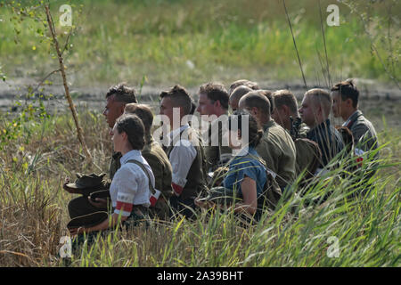 Prayer of Polish partisans from the Home Army (AK) during Military Vehicles Rally 'Operation Tempest' in Trzebinia, Poland - Stock Photo