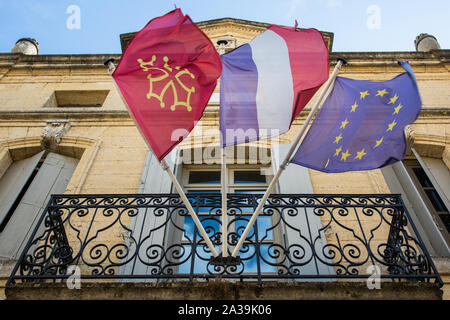 Saint-Quentin-la-Potèrie, France. 21 August, 2019. The flags of the Gard department, French Republic and European Union fly outside the town hall. Cre