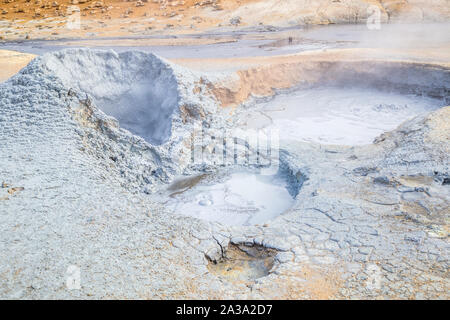 Boiling mud pots at Hverir Geothermal Area in Myvatn, Iceland - Stock Photo