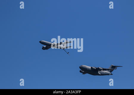 U.S. Air Force C-17 Globemaster III KC 135 Stratotanker simulated air-to-air refueling demonstration at The Great Pacific Airshow Huntington Beach USA - Stock Photo