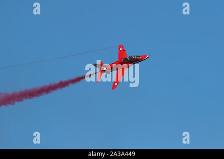 The British Royal Air Force Red Arrows Performing at The Great Pacific Airshow Huntington Beach California USA. the largest airshow in the USA - Stock Photo