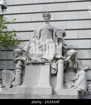 Sculpture Providence as Independent Thought, Flanked by Industry and Education, by John Massey Rhind at the John O. Pastore Federal Building in Providence, Rhode Island - Stock Photo