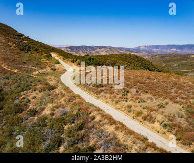 Mountain access road leads higher into the hills and wilderness of southern California. - Stock Photo