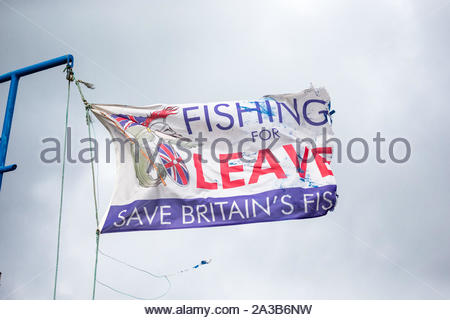 Brexit, Fishing for Leave, tattered flag flying from a boat in Tobermory harbour, Isle of Mull, Scotland.  Horizontal. Space for copy. - Stock Photo