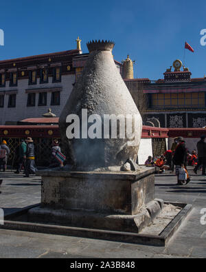 A sankang or stone incense burner smolders in Barkhor Square by the Jokhang Temple in Lhasa, Tibet.  UNESCO Historic Ensemble of the Potala Palace. - Stock Photo