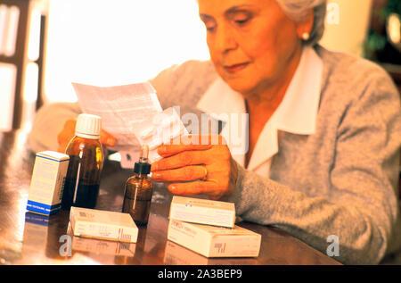elderly woman, medicine, explanatory note - Stock Photo