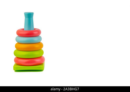 Plastic toy pyramid on a white background. Games and Copy space concept - Stock Photo