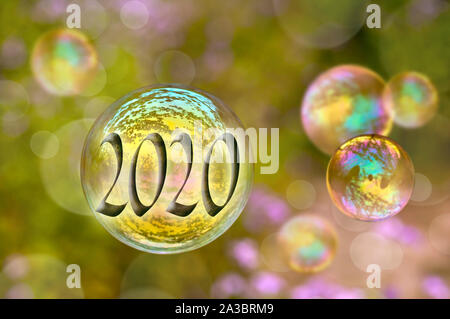 2020 soap bubble on green nature background, new year greeting card - Stock Photo