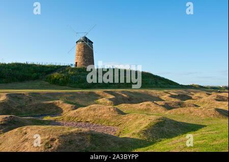 St Monans Windmill and remains of salt pans. Fife, Scotland - Stock Photo