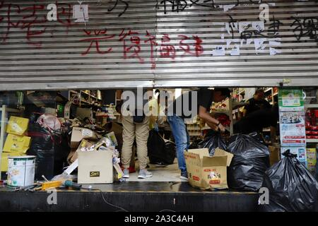 October 7, 2019, Hong Kong, CHINA: Workers clean up the mess inside the shop after the protest. Popular grocery store managed by Fukinese Capitalist Group ( a target of hate by HK pro-democracy protesters because of their Pro-Beijing position ) is being vandalized during last weekend's violent protest.Oct-7,2019 Hong Kong.ZUMA/Liau Chung-ren (Credit Image: © Liau Chung-ren/ZUMA Wire) - Stock Photo