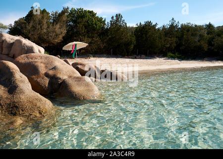 A secluded clear water, white sand beach and rocks with parasol / Plage de Santa Giulia / Santa Giulia beach, Porto-Vecchio Corsica - Corsica beach