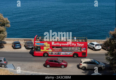 Rethymno, Crete, Greece. September 2019. An overview of a open top red bus on tour in the city of Rethymno, Crete - Stock Photo