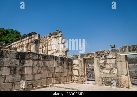 Ruins of a Synagogue in the old fishing village Capernaum, Israel. Blue sky, sunny day - Stock Photo