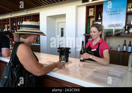 A visitor is offered a wine tasting at the Jacobs Creek visitor's centre in the Barossa Valley wine region in South Australia.   There are about 150 w - Stock Photo