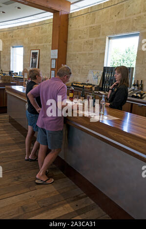A couple of visitors at Chateau Yaldara, wine tasting at the McGulgan winery  in the Barossa Valley wine region in South Australia.   There are about - Stock Photo