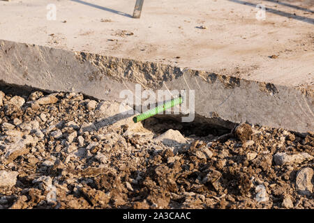 a new section of road construction with rebar - Stock Photo