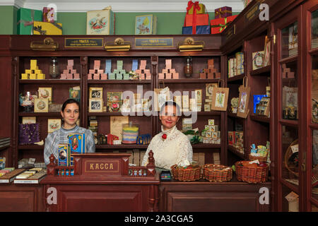 Two lovely ladies in traditional attire at the shop of the Museum of the Manufacturing of Fragrant Joys (soaps and soap products) in Kolomna, Russia - Stock Photo