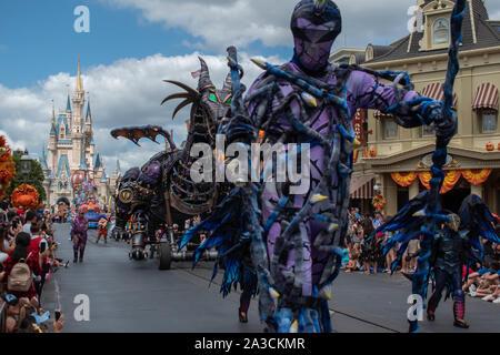 Orlando, Florida. September 25, 2019. Maleficient dragon and characters in Disney Festival of Fantasy Parade  at Magic Kigndom - Stock Photo