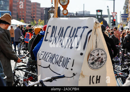 Members of the climate protection organization 'Extinction Rebellion' block traffic at Potsdamer Platz in Berlin/Germanduring a worldwide action week. - Stock Photo