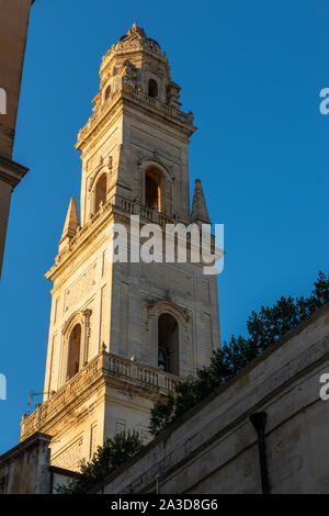 Early morning sun on bell tower of Lecce Cathedral (Duomo) - Lecce, Apulia (Puglia) in Southern Italy - Stock Photo